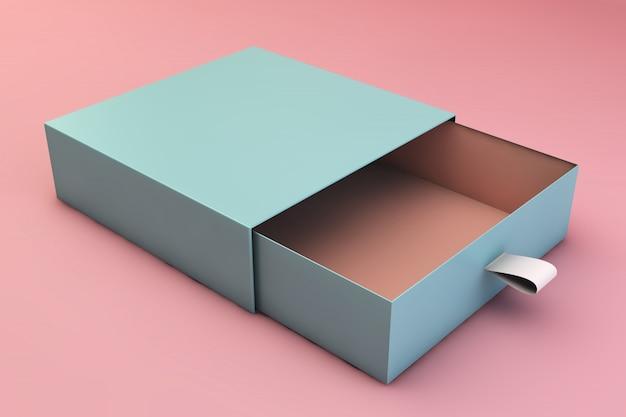 Boîte bleue sur surface rose