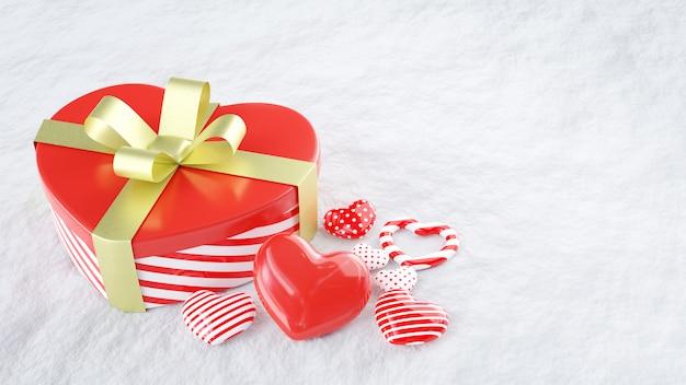 Boîte cadeau en forme de coeur rouge avec ruban d'arc doré et modèle en forme de coeur moderne sur neige blanche