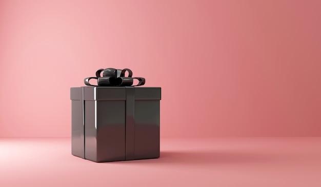 Boîte cadeau noire sur rose avec lumière