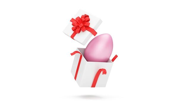 Boîte-cadeau avec oeuf de pâques rose à l'intérieur isolé sur mur blanc