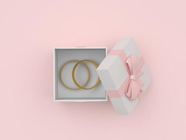 Boîte cadeau ouverte avec anneaux de mariage en or