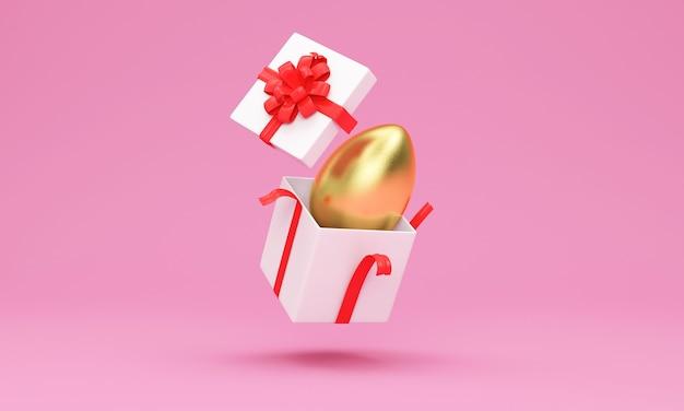Boîte-cadeau ouverte avec oeuf de pâques doré à l'intérieur sur rose