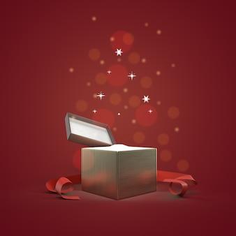 Boîte cadeau ouverte avec des particules brillantes