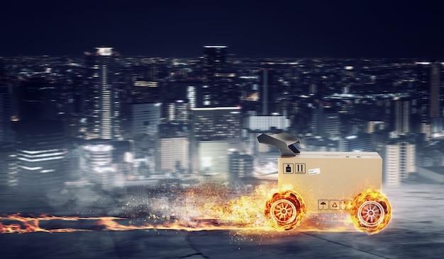 Boîte en carton prioritaire avec des roues de course en feu. expédition rapide par route.