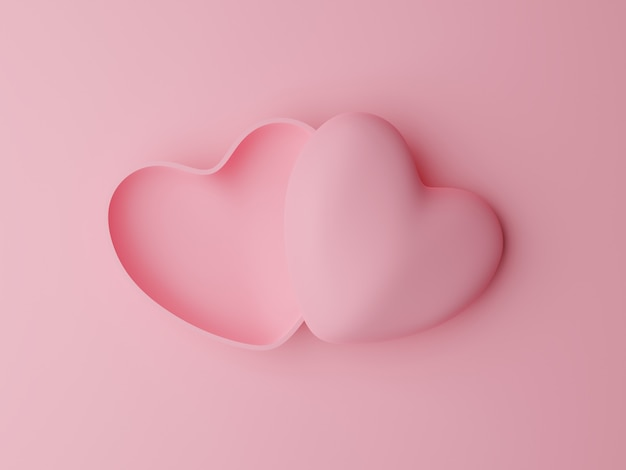 Boîte en forme de coeur pastel rose ouvert sur table rose. concept de la saint-valentin