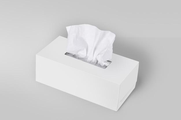Boîte à mouchoirs blanc sur fond gris avec mouchoirs
