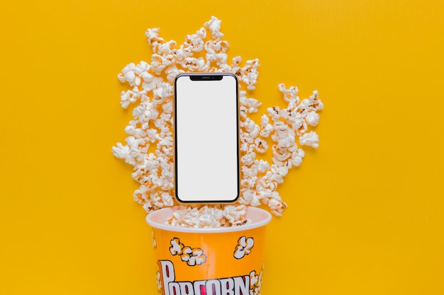Boîte à pop-corn avec téléphone portable