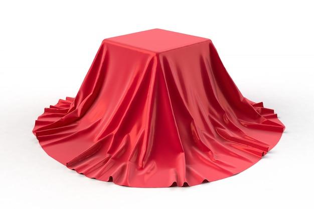 Boîte recouverte de tissu rouge.