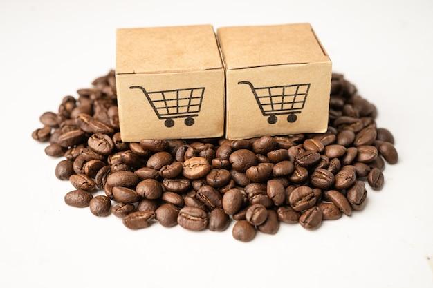 Boîte avec symbole du logo du panier d'achat sur les grains de café, import export shopping en ligne ou service de livraison ecommerce expédition de produits, commerce, concept de fournisseur