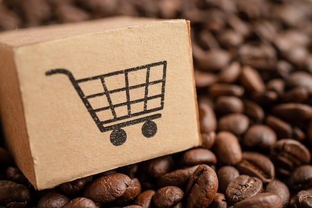 Boîte avec le symbole du logo du panier sur les grains de café import export shopping en ligne