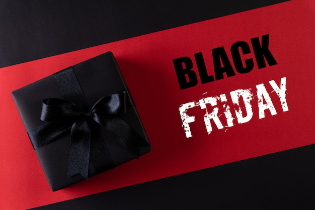 Boîtes de noël noires avec fond pour texte. black friday et boxing day