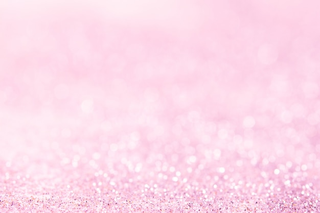Bokeh abstrait paillettes rose floue