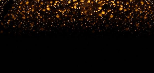 Le bokeh doré floue de fond abstrait.