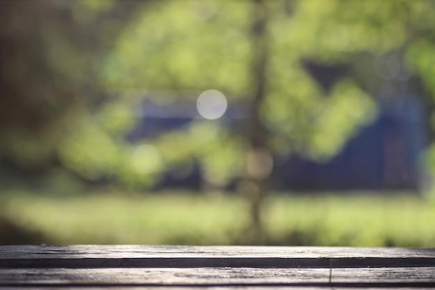 Bokeh extérieur en bois de table de fond