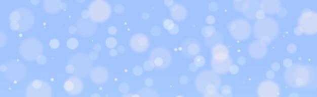 Bokeh flou blanc sur un fond bleu abstrait
