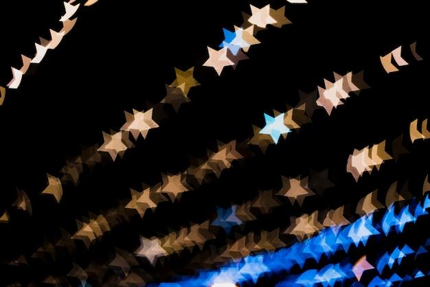 Bokeh fond avec des lumières en forme d'étoile