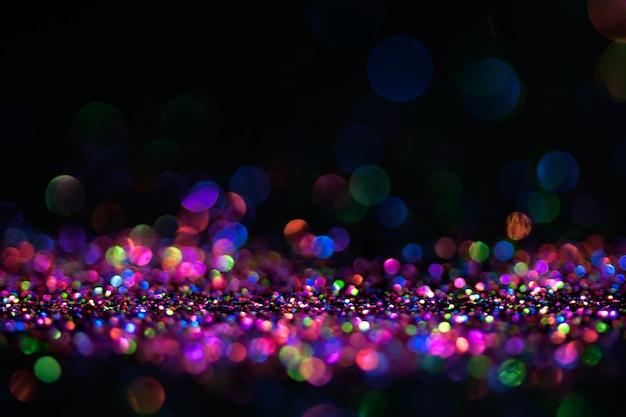 Bokeh paillettes mouche et lumières sur fond noir