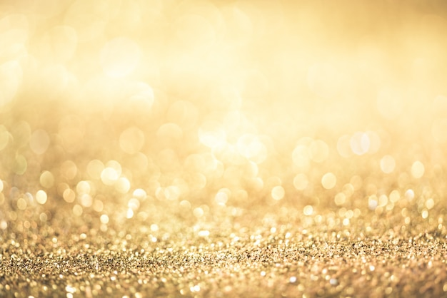 Bokeh de paillettes d'or coloré abstrait flou pour anniversaire