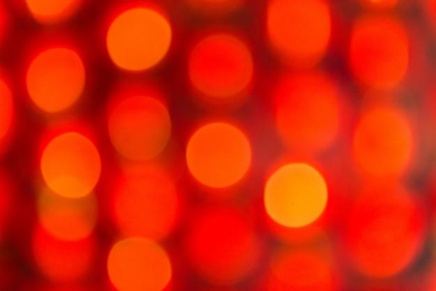 Bokeh de vacances rouge et orange. abstrait