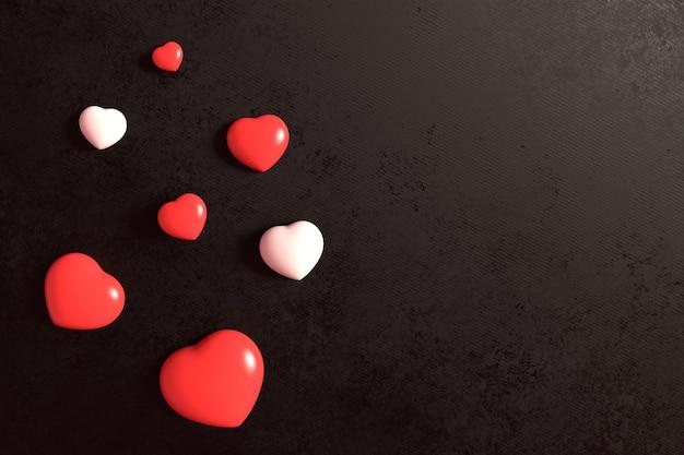 Bonbons au chocolat rouge et blanc sur fond de cuir noir. saint valentin et concept de romance d'amour.