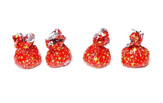 Bonbons De Fête Dans Un Emballage Rouge Photo Premium
