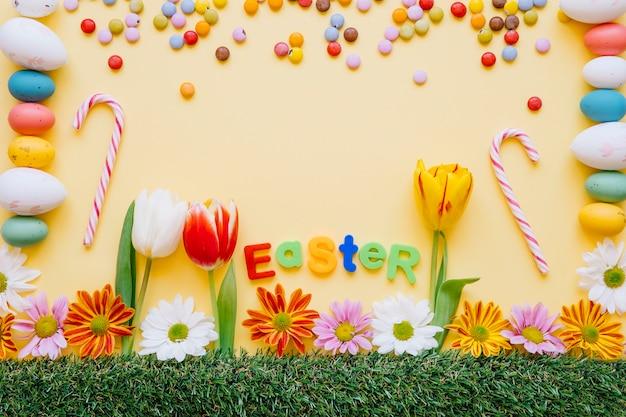 Bonbons lumineux et des fleurs pour les vacances de pâques