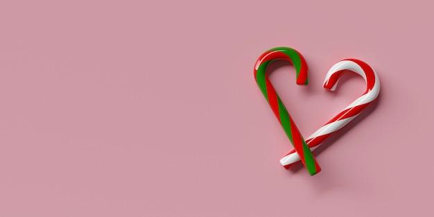 Les bonbons de noël peuvent en forme de coeur sur rose