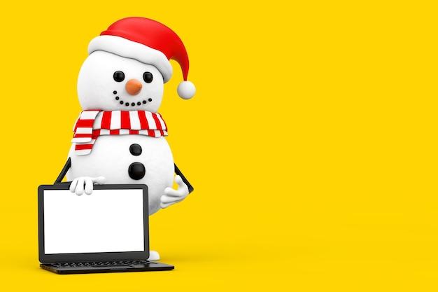 Bonhomme de neige en mascotte de personnage de chapeau de père noël et ordinateur portable moderne avec écran blanc pour votre conception sur fond blanc. rendu 3d