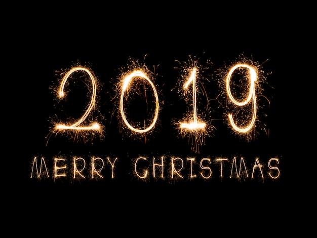 Bonne année 2019 écrite avec le feu d'artifice sparkle