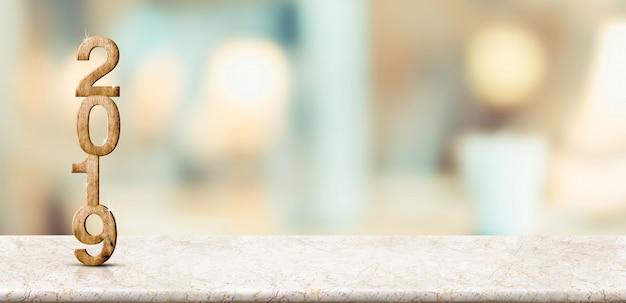 Bonne année 2019 sur table de marbre avec mur de bokeh doux