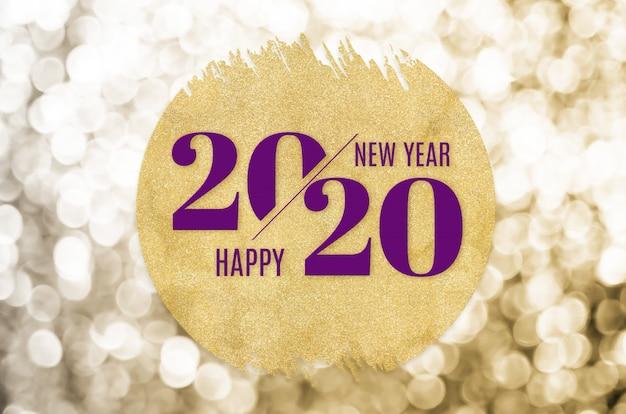 Bonne année 2020 mot sur le cercle d'or paillettes sur les lumières de bokeh d'or