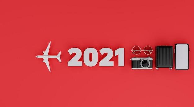 Bonne année 2021: maquette mobile à écran blanc avec avion, appareil photo, bagages et lunettes de soleil