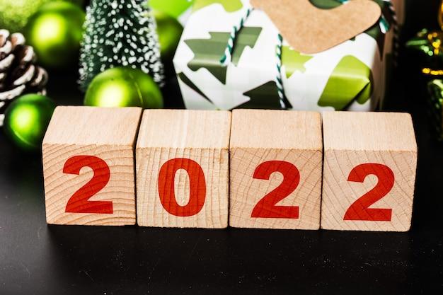 Bonne année 2022 noël 2022 cadeaux de noël placés dans une ambiance festive