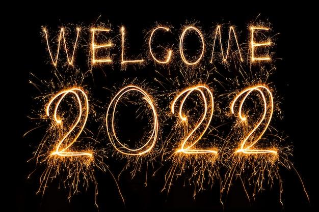 Bonne année 2022 texte brûlant mousseux bonne année 2022 isolé sur fond noir beauti