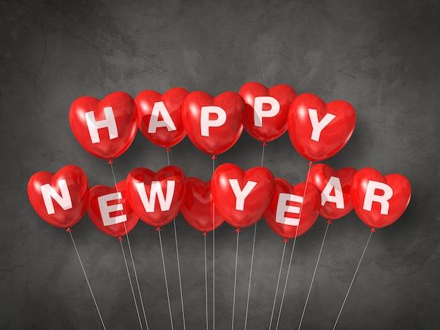 Bonne année rouge des ballons à air en forme de coeur sur un béton foncé