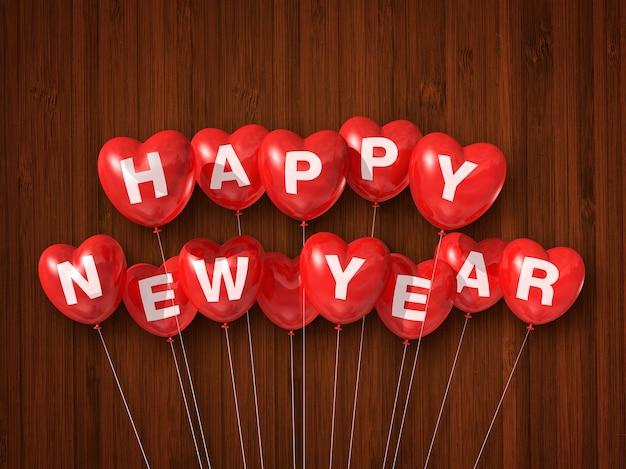Bonne année rouge des ballons à air en forme de coeur sur un bois foncé