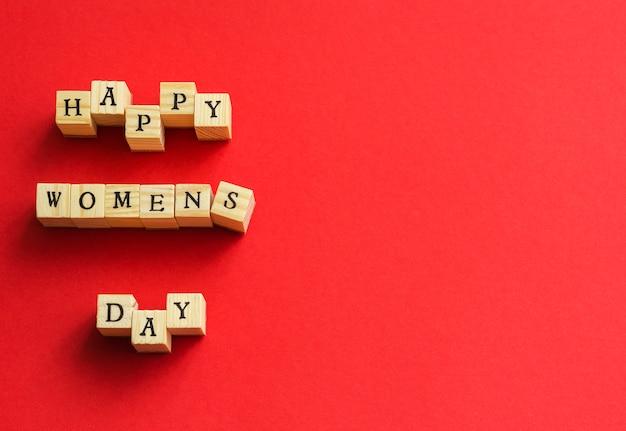 Bonne journée des femmes de cubes en bois avec des lettres