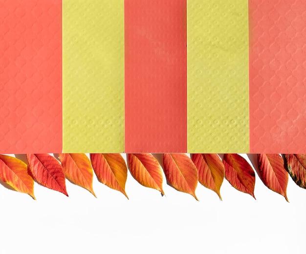 Bordure d'automne décorative en jaune, orange sur blanc.