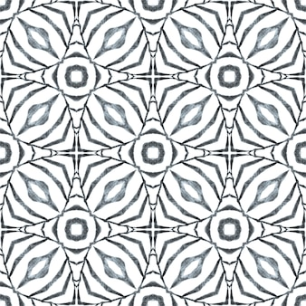 Bordure de tuile répétitive ikat aquarelle. design d'été boho chic exotique noir et blanc. ikat répétant la conception de maillots de bain. textile prêt à imprimer magnifique, tissu de maillot de bain, papier peint, emballage.