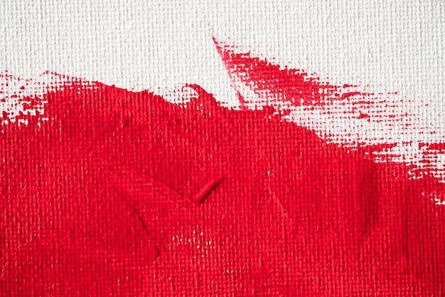 Bouchent la peinture de couleur rouge texture sur toile blanche