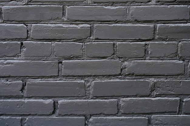 Bouchent la photo de la vue détaillée du fond de fond de mur de brique élégant style moderne noir texturé à la mode