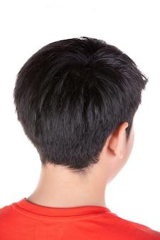 Bouchent la tête du dos d'un garçon asiatique.