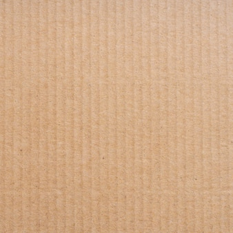 Bouchent la texture de la boîte de papier carton brun et fond.