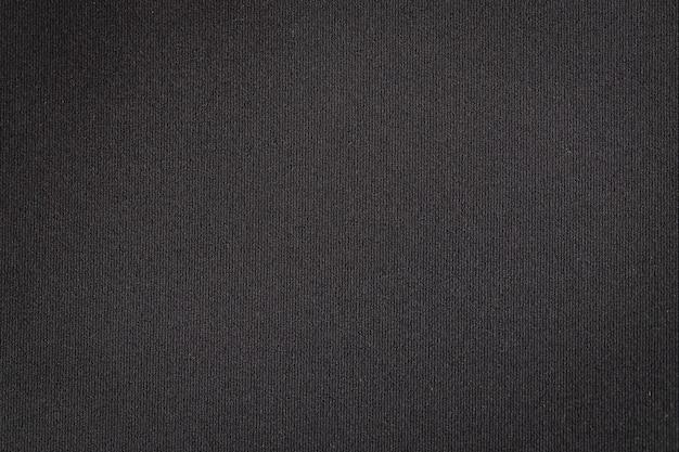 Bouchent la texture du tissu noir. fond de textile.