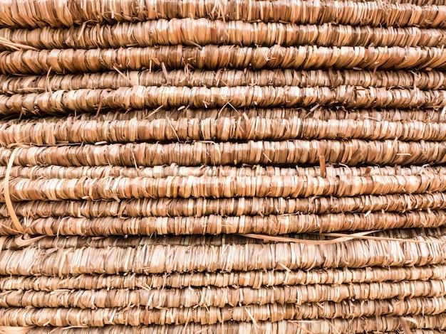 Bouchent la texture du toit de chaume brun