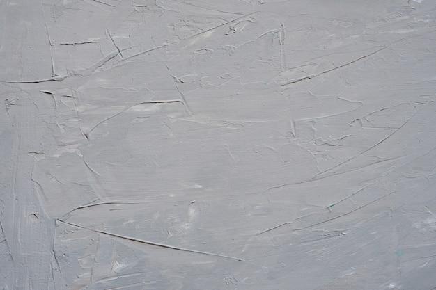 Bouchent la texture de la peinture de couleur grise sur le mur de ciment.