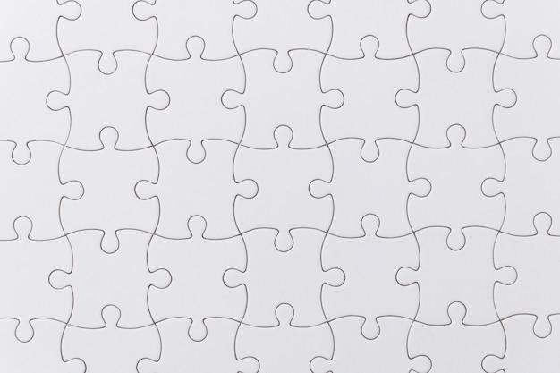Bouchent la texture de puzzle blanc