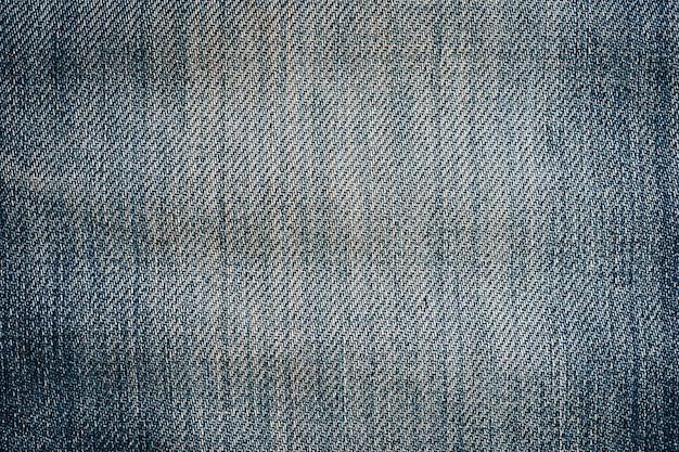 Bouchent la vieille texture de jeans et l'arrière-plan avec l'espace.