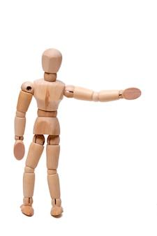 Bouchent la vue d'un mannequin en bois faisant de l'auto-stop isolé sur fond blanc.