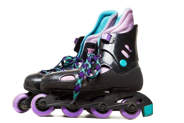 Bouchent la vue des patins à roues alignées isolé sur fond blanc.